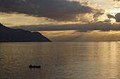 Boat on Lake Geneva at sunset, Veytaux, Vaud, Switzerland