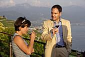 Woman smelling wine, winetasting, Lavaux, Canton of Vaud, Switzerland