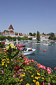 View over lake Geneva to Hotel Chateau d'Ouchy, Lausanne, Canton of Vaud, Switzerland