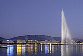 Illuminated Jet d'Eau at night, one of the largest fountains in the world, Lake Geneva, Geneva, Canton of Geneva, Switzerland