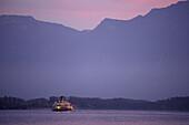 Excursion boat on Lake Geneva arriving Chillon Castle, Veytaux, Vaud, Switzerland