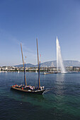 Traditional cargo sailer and Jet d'Eau, one of the largest fountains in the world, Lake Geneva, Geneva, Canton of Geneva, Switzerland