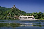 Excursion boat on river Moselle, Reichsburg in background, Cochem, Rhineland-Palatinate, Germany