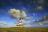 Westerhever lighthouse under cloudy sky, Eiderstedt peninsula, North Friesland, Schleswig-Holstein, Germany