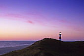 Lighthouse in the dunes in the afterglow, Ostenellenbogen, Sylt island, North Friesland, North Sea, Schleswig-Holstein, Germany