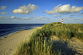 Lighthouse in the dunes under cloudy sky, Ostenellenbogen, Sylt island, North Friesland, North Sea, Schleswig-Holstein, Germany
