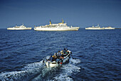 People in a motor boat on their way to excursion boats on the sea, North Friesland, North Sea, Schleswig-Holstein, Germany