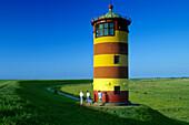 Lighthouse under blue sky, East Friesland, Lower Saxony, Germany