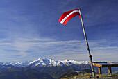 Austrian flag on mount Hundstein, Hohe Tauern range in background, Salzburg Slate Alps, Salzburg, Austria