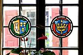 Window with emblem, Hotel and Restaurant Löwen, Marktbreit, Franconia, Bavaria, Germany