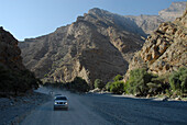 All-terrain vehicles on a country road in the mountains, Al Hajar mountains, Wadi Bani Auf, Oman, Asia