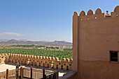People visiting the Fort Jabrin on a sunny day, Oman, Asia