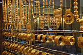 Gold jewellery in a shop at the Matrah district, Muscat, Oman, Asia