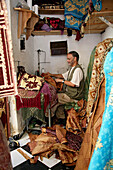 A tailor at his workshop at the medina of Fes, Morocco, Africa