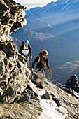 A man, a mountain guide, Simon Anthamatten, climbing the Matterhorn on the Hoernligrat with a client, early in the morning, Zermatt, Switzerland, Wallis, Alps, MR