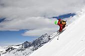 Young man downhill skiing, Stockhorn, Zermatt, Canton of Valais, Switzerland