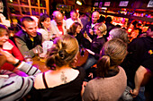 A lot of people in the Apres Ski bar Le Pub, Zinal. Wallis, Valais, Switzerland, Alps.