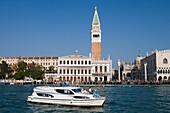 Le Boat Magnifique houseboat with the Campanile Tower and Basilica di San Marco, Venice, Veneto, Italy