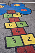 Hopscotch in a childrens playground, School, Oberhausen, North Rhine-Westphalia, Germany