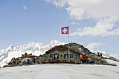 Mountain hut in a mountain landscape, Swiss Flag, St. Gotthard, Switzerland
