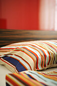 Pillows with stripes in sleeping room