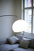modern illuminated lamp, sofa with pillows, without colours