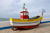 Colourful fishing boat in the historical and old fishing and seaside village Ericeira, Portugal, Atlantic