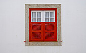 Window with red window shutters, Historical, old fishing village of Ericeira, Portugal