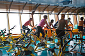 People exercising in the fitness room of cruise ship AidaDiva
