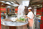 A cook working in the kitchen of cruise ship AidaDiva