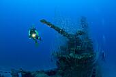 Diver and 5-inch Deck Gun of USS Apogon Submarine, Marshall Islands, Bikini Atoll, Micronesia, Pacific Ocean