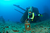 Diver finds Artifacts on Flight Deck of USS Saratoga, Marshall Islands, Bikini Atoll, Micronesia, Pacific Ocean