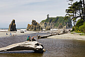 People at the rocky West Coast of the Olympic Peninsula, Washington, USA