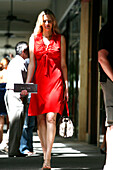 Young woman wearing a red dress, Bal Harbour Shopping Center, Surfside, Miami Beach, Florida, USA