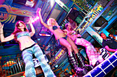 Young women dancing at Mango's Nightclub, Ocean Drive, South Beach, Miami Beach, Florida, USA
