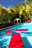 The deserted pool of the Catalina Beach Club Hotel in the sunlight, South Beach, Miami Beach, Florida, USA