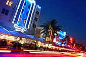 Neon sign at hotels on Ocean Drive at night, South Beach, Miami Beach, Florida, USA