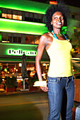 Young woman on Ocean Drive, South Beach, Miami Beach, Florida, USA