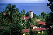 The buildings of the catholic mission under palm trees, Waikiri, Island of Taveuni, Fiji, South Seas, Oceania