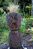 Carved figure at the garden of the Treetops Lodge, North Island, New Zealand, Oceania