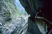 A deserted track in a rock face with view at the Taroko Gorge, Taroko National Park, Taiwan, Asia