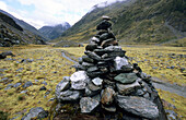 Cairn on the Rees Dart Track at upper Dart Valley, Mt. Aspiring National Park, South Island, New Zealand, Oceania