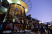 People sitting in restaurants at King Street Wharf in the evening, Darling Harbour, Sydney, New South Wales, Australia