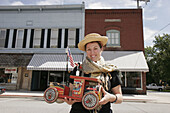 Yoder Brothers Antiques, woman, toy truck. Elkhart Street. Wakarusa. Indiana. USA.