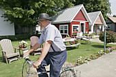 Courtyard of Arts, Amish man, bicycle. Shipshewana. Indiana. USA.