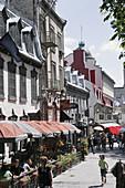 Canada, Quebec City, Upper Town, Rue Sainte Anne, restaurants, alfresco dining, umbrellas, historic buildings