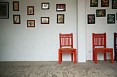 Absence, Absent, Chair, Chairs, Color, Colour, Concept, Concepts, Contemporary, Decoration, Indoor, Indoors, Interior, Nobody, Painting, Paintings, Pair, Red, Two, Wall, Walls, Wood, Wooden, G26-708179, agefotostock