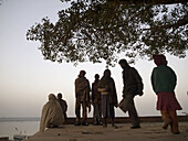 Pilgrims gather in the early morning near the Ganga river (in accordance with the Hindu belief that bathing in the river will wash away sins) in Varanasi, India, a sacred Hindu pilgrimage site.