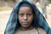 Africa, African, Africans, Black child, Black children, Child, Childhood, Children, Color, Colour, Contemporary, Country, Countryside, Daytime, Ethiopia, Ethnic, Ethnicity, Exterior, Face, Faces, Facial expression, Facial expressions, Facing camera, Girl,