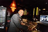 DJ Jimmy Knowles in the Taj Lounge Salsa club, Manhattan, New York City, New York, USA